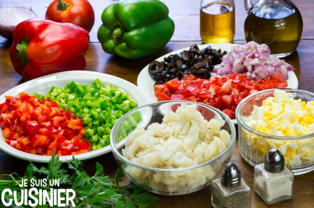 Salade de haricots blancs à la morue (couper les légumes)